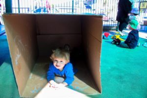 Beverly Montessori child playing in a box
