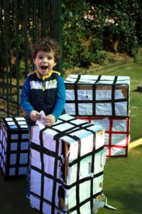 Beverly Montessori child playing with boxes
