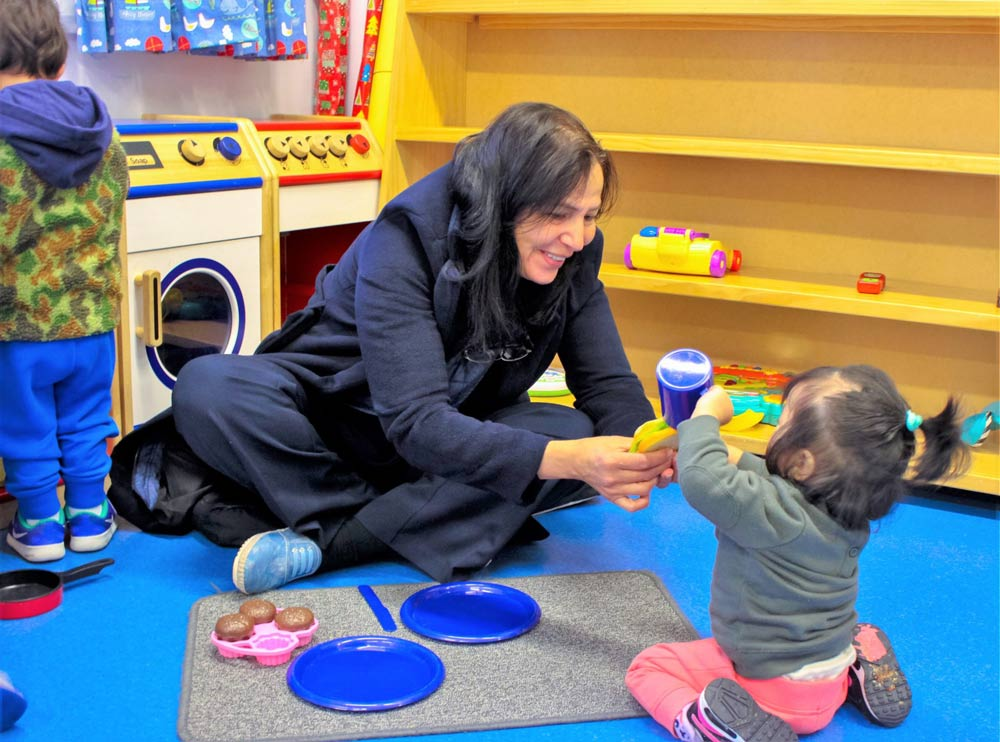 Beverly Montessori teacher with a toddler